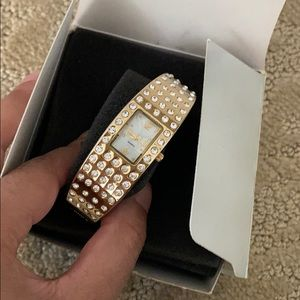 Avon golden diamond watch